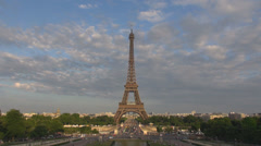 Panoramic view Eiffel Tower blue sky cloud pass traffic car street bridge Paris Stock Footage