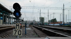 Semaphore between railway tracks. Fast moving train Stock Footage