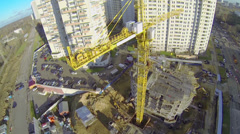 Tall crane works on construction site of dwelling complex Stock Footage