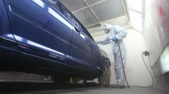 Varnishing process of a blue car Stock Footage