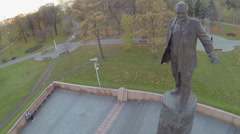 Monument for S.Korolev in public garden with people Stock Footage