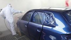 Varnishing a blue car Stock Footage