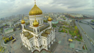 Stock Video Footage of cupolas of Christ the Saviour Cathedral against Kremlin complex
