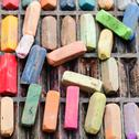 Stock Photo of set of many used artistic dry pastels