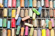 Stock Photo of pack of many used artistic dry pastels