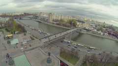 Traffic by quay near Patriarshy bridge and cityscape Stock Footage
