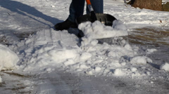 Man with a snow shovel in winter episode 2 Stock Footage
