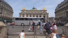 Opera Garnier theatre palace beautiful Paris traffic car street tourist people  Stock Footage