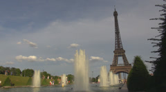 Eiffel tower fountain water blues sky french symbol icon scene summer day Paris Stock Footage