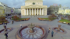 People walk by square near edifice of Bolshoy Theater Stock Footage