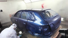 Time lapse of a car being painted and varnished in a painting chamber Stock Footage