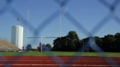 Football Stadium Behind Fence Stock Footage