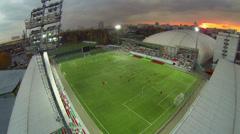 Football team plays on Small Sports Arena of Locomotive stadium Stock Footage