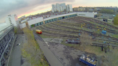 Cityscape with stadium and many railroad tracks Stock Footage
