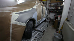A gray car ready for the painting chamber Stock Footage