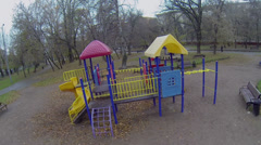 Stock Video Footage of Colorful construction on childish playground at autumn day