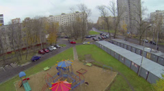 Kids playground on yard near garages at street with tramway line Stock Footage