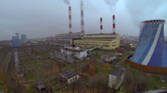 Power plant tubes emit smoke and steam at autumn evening Stock Footage