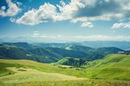 Stock Photo of summer mountains green grass and blue sky landscape