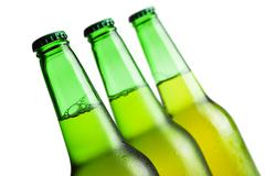 Three green beer bottles isolated over white background Stock Photos