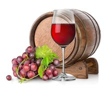 Wineglass with grape and barrel - stock photo