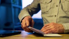 Man opens and sign a letter to the document Stock Footage