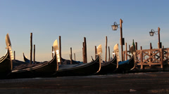 A row of Gondolas bobbing up & down in Venice Stock Footage