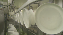 Producing traditional cheese: cleaning white buckets Stock Footage