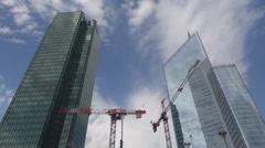 Crane built financial business corporate day La Defense Paris high skyscraper Stock Footage