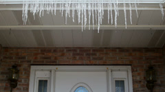 Icicles dripping on house front porch Stock Footage