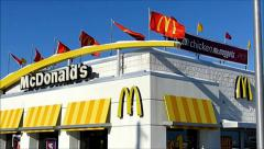 McDonalds rooftop waving flags Stock Footage