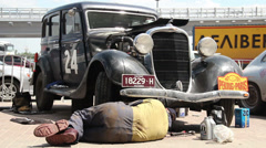 Dodge DR Special, 1934, repair man under vehicle changing oil - stock footage