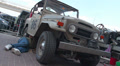 Toyota Landcruiser FJ40, 1960 from Brazil, repairman fixing car Footage