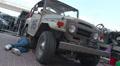 Toyota Landcruiser FJ40, 1960 from Brazil, repairman fixing car HD Footage