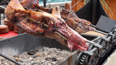 Turning and roasting Pork above embers Stock Footage