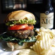 Hamburger and beer - pub food Stock Photos