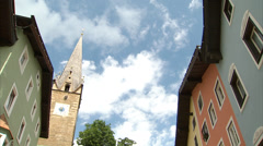 Kitzbühel clock tower and city centre Stock Footage