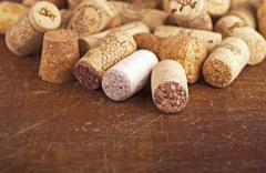 Bottle corks on the wooden background Stock Photos