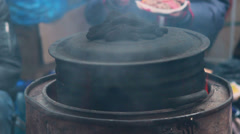 Field kitchen for poor people, dirty pan meal cooking outdoors Stock Footage