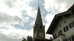 Timelapse of Kitzbühel church tower Stock Footage