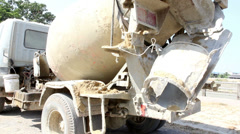Cement Truck running cement mixing Stock Footage
