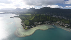 Aerial Shot of the coral reef and residential area in Hawaii Stock Footage
