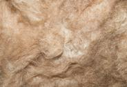 Stock Photo of close up of a glass wool roll for insulation purpose, side view with details