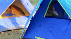 Closeup to Tent camping beside natural lake Stock Footage