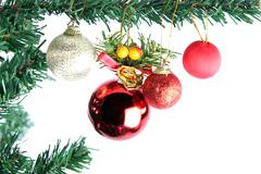 The red balls hanging on christmas tree. Stock Photos