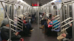 Inside subway train blur anonymous people commuter riders Stock Footage