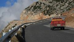 Mountain road car guardrail Stock Footage