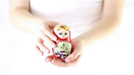 Stock Video Footage of Hands  showing traditional babushka doll