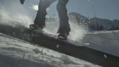 SLOW MOTION: Snowboarder riding kink rail Stock Footage