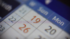 Stock Video Footage of Flipping through calendar on screen